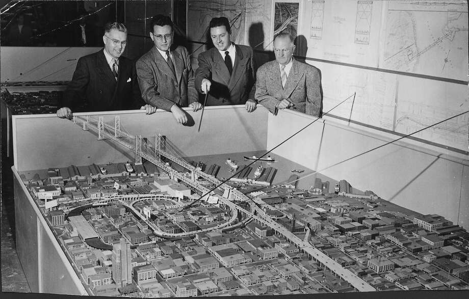 Ralph A. Tudor, chief engineer, H.W. Alexander, Emporium executive, Don Gazackerly and Tom Maloney look at a model of a proposed second Bay Bridge crossing that was never actualized on November 16, 1948. Photo: File, The Chronicle