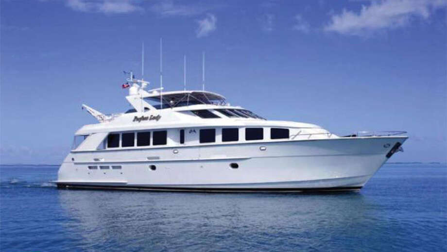 The Perfect Lady is an 84-foot Hatteras motor yacht moored in the Foss Waterway