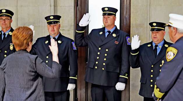 Albany Mayor Kathy Sheehan swears one captain and three lieutenants during promotion ceremony for four Albany firefighters in the rotunda of Albany City Hall May 19, 2015 in Albany, N.Y.     (Skip Dickstein/Times Union) Photo: SKIP DICKSTEIN / 00031903A