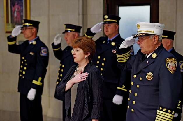 Albany Mayor Kathy Sheehan is joined by members of the Albany Fire Department in the Pledge of Allegiance during promotion ceremony for four of firefighters in the rotunda of Albany City Hall May 19, 2015 in Albany, N.Y.  One Lieutenant was promoted to Captain and three firefighters were promoted to Lieutenant.      (Skip Dickstein/Times Union) Photo: SKIP DICKSTEIN / 00031903A