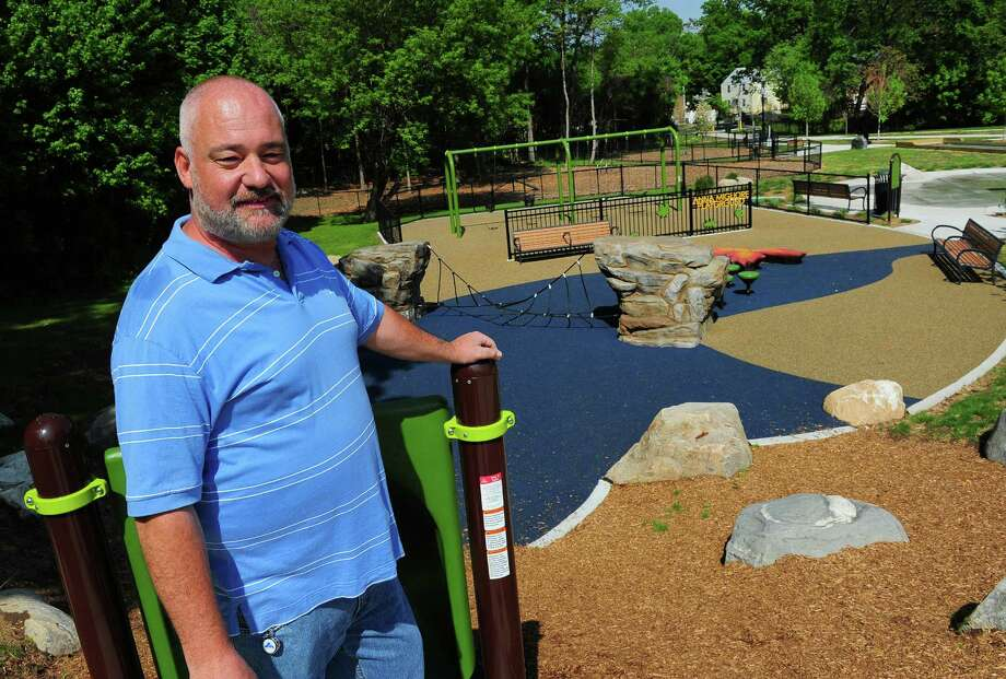 Joel Bing, Chairman of Derail the Jail Committee, poses at the newly constructed Nob Hill Park off of Virginia Ave in Bridgeport, Conn. on Tuesday May 19, 2015. In 2009, Governor Jodi M. Rell proposed a 36,000 square foot juvenile detention center for girls on the site. The park also boasts the city's first dog park which ironically is named after Bing's cat, Bandit Bear Bing. Photo: Christian Abraham / Connecticut Post
