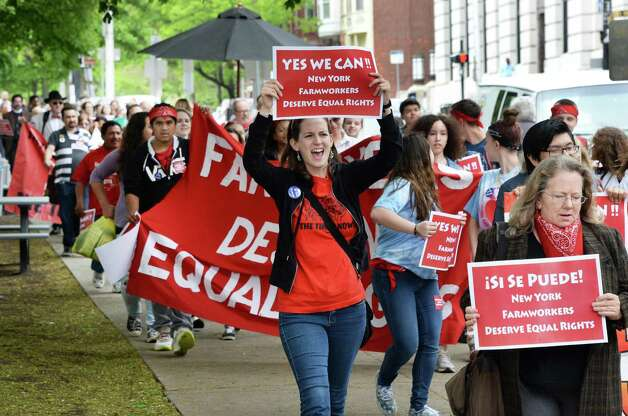 Advocates for New YorkOs farmworkers calling for the passage of the Farmworkers Bill of Rights, march to the Capitol Tuesday May 19, 2015, in Albany, NY.  (John Carl D'Annibale / Times Union) Photo: John Carl D'Annibale / 00031901A