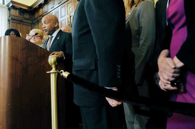 Assembly Speaker Carl Heastie, surrounded by his fellow members, addresses those gathered for a press conference on rent regulations at the Capitol on Tuesday, May 19, 2015, in Albany, N.Y.  (Paul Buckowski / Times Union) Photo: PAUL BUCKOWSKI / 00031902A