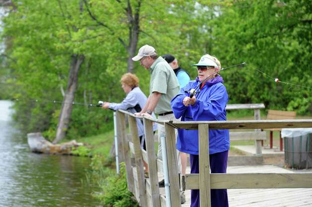 Carole Trifiletti of the Colonie Seniors, right, casts her line during a Department of Environmental Conservation Free Sport Fishing Clinic on Tuesday, May 19, 2015, at Six Mile Waterworks in Albany, N.Y. The clinics, which are held across the state, allow would-be-fishing enthusiasts the chance to receive instruction and try the sport without a license. For more information visit www.dec.ny.gov. (Cindy Schultz / Times Union) Photo: Cindy Schultz / 00031852A