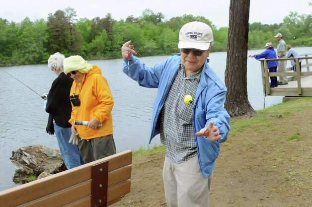 Ted Yoshinari, center, joins fellow members of the Colonie Seniors during a Department of Environmental Conservation Free Sport Fishing Clinic on Tuesday, May 19, 2015, at Six Mile Waterworks in Albany, N.Y. The clinics, which are held across the state, allow would-be-fishing enthusiasts the chance to receive instruction and try the sport without a license. For more information visit www.dec.ny.gov. (Cindy Schultz / Times Union) Photo: Cindy Schultz / 00031852A