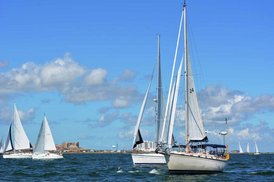 Sailboats set out from at the start of Lakewood Yacht Club's annual Harvest Moon Regatta, from Galveston to Port Aransas, Oct. 9, 2014. This year's regatta is set for Oct. 22-25. Photo: Roberta MacInnis /Houston Chronicle / ONLINE_YES
