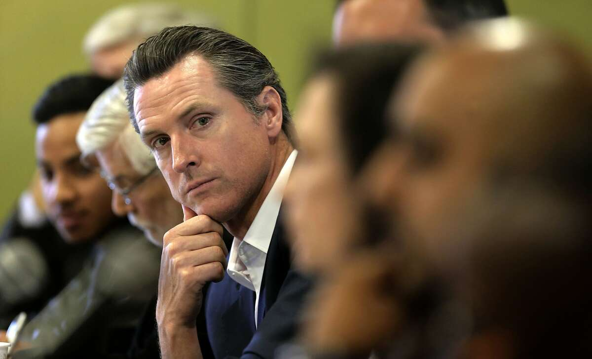 California Lt. Gov. Gavin Newsom listens to fellow panel members during a public forum of The Blue Ribbon Commission on Marijuana Policy at the Youth Uprising Center on Tues. May 19, 2015, in Oakland, Calif.