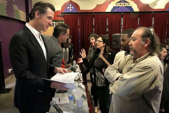 Mark Phillips, (right) who has children in the Hayward Unified School District talks about his concerns with the legalizartion of Marijuana with California Lt. Gov. Gavin Newsom's the head of The Blue Ribbon Commission on Marijuana Policy, during a public forum at the Youth Uprising Center in Oakland, Calif., on Tues. May 19, 2015.
