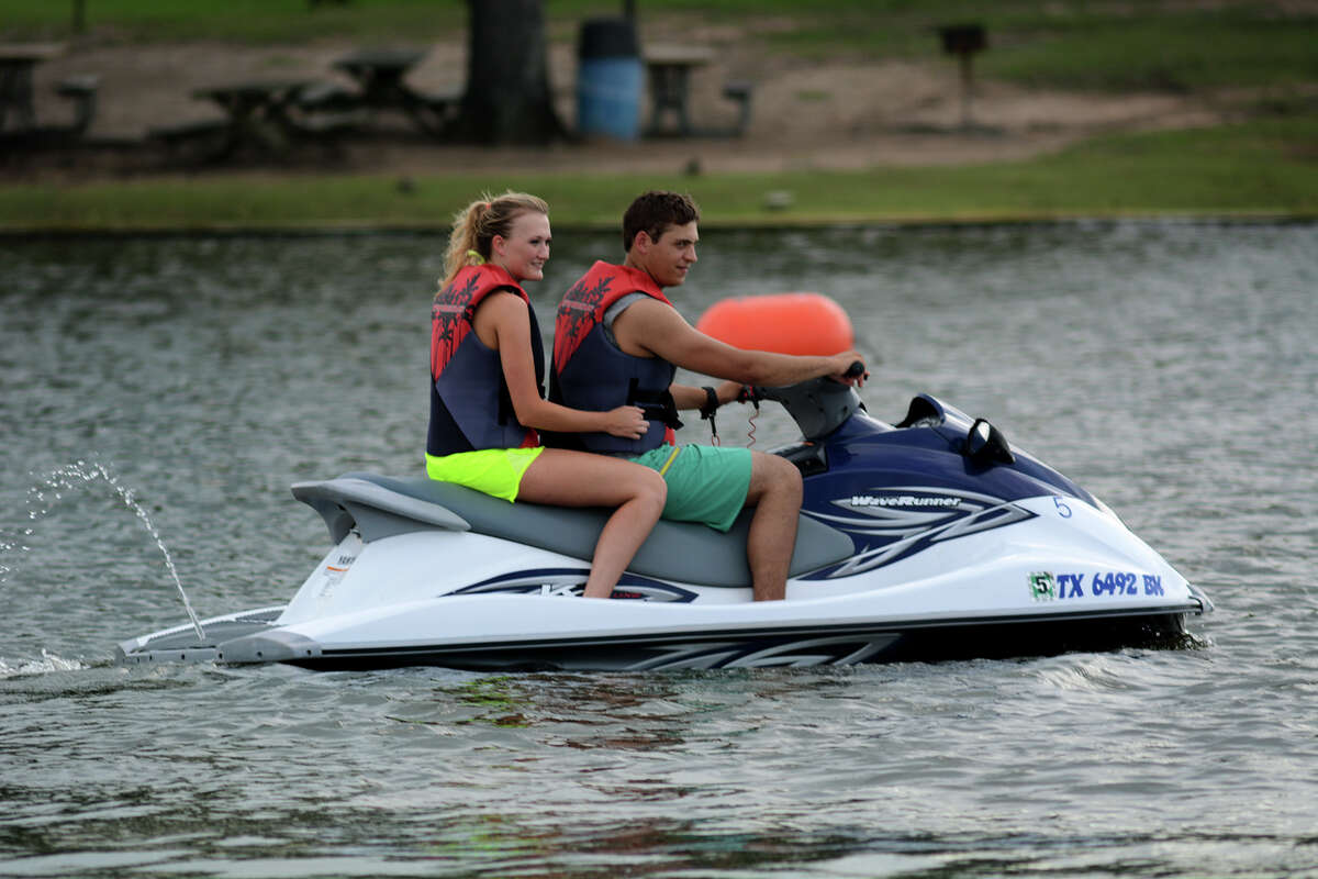 Jacob Anastasiades, of Navasota, celebrating his 21st birthday today, and Nickayla Floyd, 19, of Plantersville, ride a jet ski from Lake Conroe Water Sports at Papa's on the Lake on Lake Conroe Monday afternoon, May 18, 2015. Jacob is a student at Lone Star College - CyFair studying welding and Nickayla is a sophomore at Texas A&M majoring in Allied Health. (Photo by Jerry Baker/Freelance)