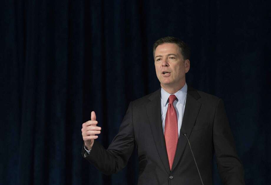 Federal Bureau of Investigation (FBI) Director James Comey addresses the American Law Institute's annual meeting in Washington, DC, May 19, 2015.   AFP PHOTO/JIM WATSONJIM WATSON/AFP/Getty Images Photo: JIM WATSON / AFP / Getty Images / AFP
