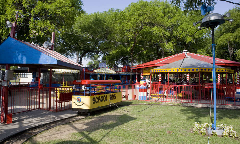 Kids love to ride on the yellow school bus ride at Kiddie Park. Photo: Courtesy Photo