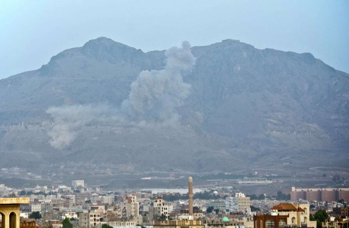Smoke rises after a Saudi-led airstrike hit a site believed to be one of the rebels' largest weapons depot on the outskirts of Yemen's capital, Sanaa.