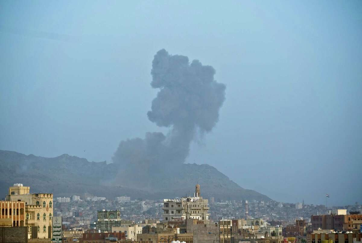 Smoke rises after a Saudi-led airstrike hit a site believed to be one of the largest weapons depot on the outskirts of Yemen's capital, Sanaa, on Tuesday, May 19, 2015. The Saudi-led coalition on Tuesday carried out the heaviest airstrikes near the Yemeni capital since a five-day truce with Yemen's Shiite rebels expired earlier this week, hitting weapons depots in the mountains surrounding Sanaa and sending dozens of families fleeing their homes in panic. (AP Photo/Hani Mohammed)