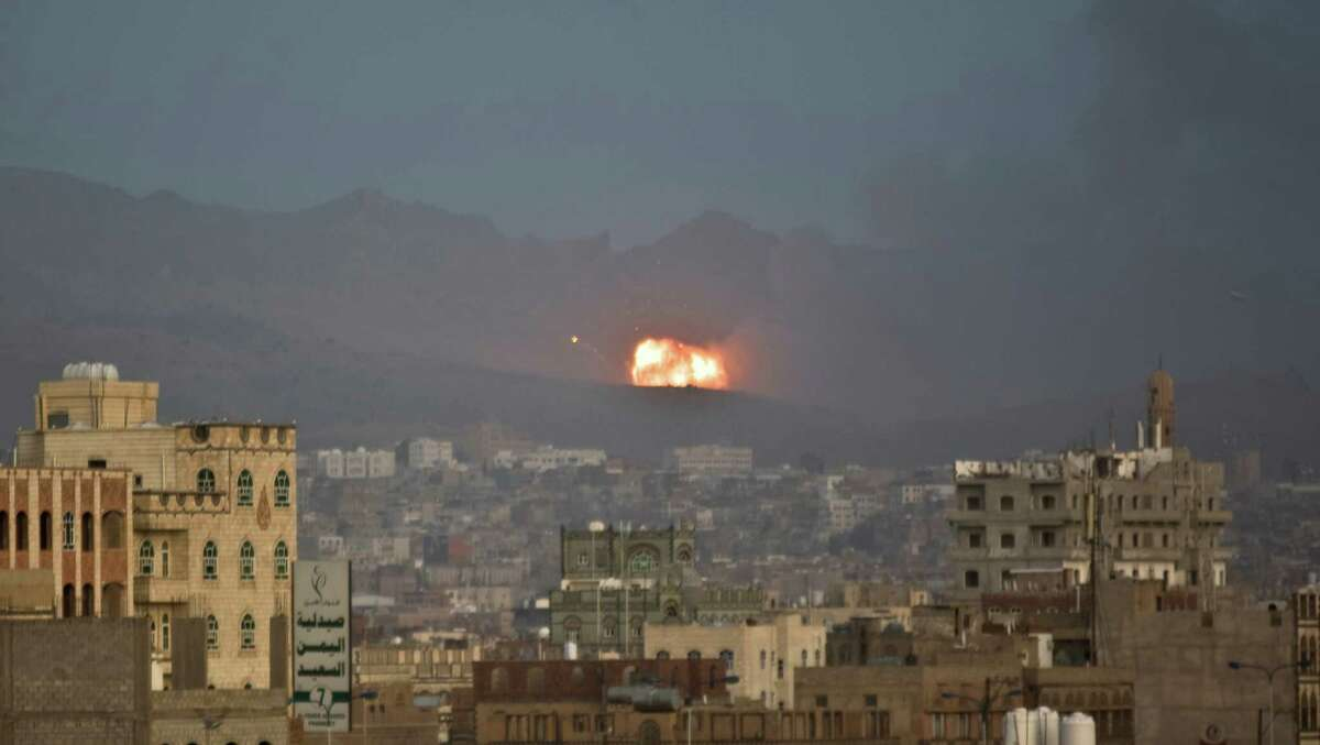 Flames and smoke rise after a Saudi-led airstrike hit a site believed to be one of the largest weapons depot on the outskirts of Yemen's capital, Sanaa, on Tuesday, May 19, 2015. The Saudi-led coalition on Tuesday carried out the heaviest airstrikes near the Yemeni capital since a five-day truce with Yemen's Shiite rebels expired earlier this week, hitting weapons depots in the mountains surrounding Sanaa and sending dozens of families fleeing their homes in panic. (AP Photo/Hani Mohammed)