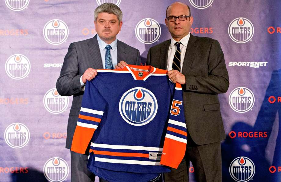 Todd McLellan (left), late of the Sharks, is introduced as Edmonton Oilers coach by General Manager Peter Chiarelli. Photo: Jason Franson / Associated Press / CP