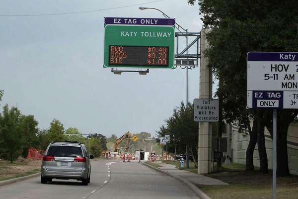 Motorists drive toward the Katy Managed Lanes near the METRO Addicks Park and Ride location. Road officials are raising tolls, hoping it will force drivers to pick another option.