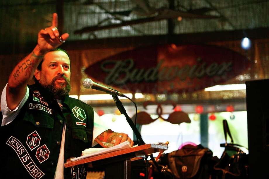"""Pastor David Loa preaches during a 2010 service of the Street Heat Ministries """"Bones on Fire"""" Biker Church service at the County Line Bar and Grill in Richmond. Loa is often heard rallying his congregation with, """"From the church house to the icehouse, from the church seats to the biker streets."""" Photo: Staff / Houston Chronicle"""