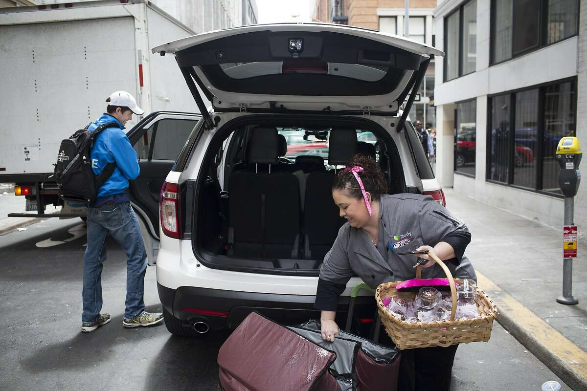 Rachel Powell loads her Zesty catering bags into her Lyft car in San Francisco, Calif. on Tuesday, May 19, 2015.