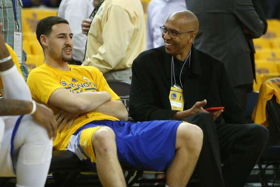 Golden State Warriors' Klay Thompson and his father Mychal Thompson chat before the Warriors play the Houston Rockets in Game 1 of NBA Playoffs' Western Conference Finals at Oracle Arena in Oakland, Calif., , on Tuesday, May 19, 2015.