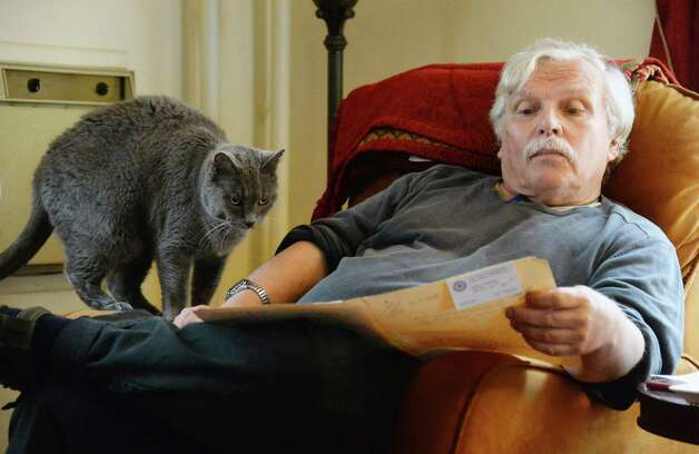 Ed Landing, a retired state geologist and a victim of identity theft, looks over documents he's put together as he tries to get back his stolen IRS federal tax return Wednesday, May 13, 2015, in Albany, N.Y.  (John Carl D'Annibale / Times Union) Photo: John Carl D'Annibale / 00031830A