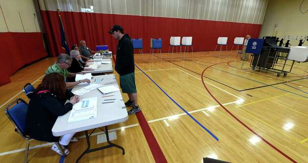 Business was slack at the Gulderland Elementary School's voting booths during the  early morning of school voting May 19, 2015 in Albany, N.Y.      (Skip Dickstein/Times Union) Photo: SKIP DICKSTEIN / 00031876A