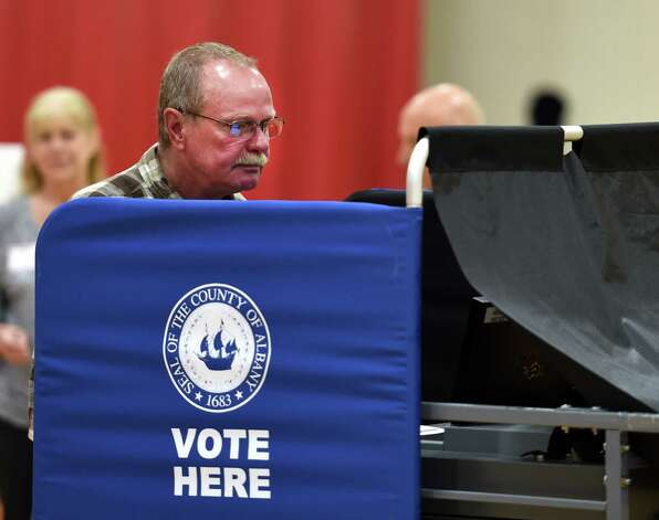Matt Pruskowski casts his vote at the Gulderland Elementary School during the  early morning of school voting May 19, 2015 in Albany, N.Y.      (Skip Dickstein/Times Union) Photo: SKIP DICKSTEIN / 00031876A