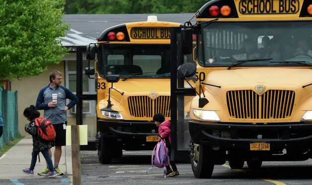 Students exit buses at the Gulderland Elementary School during the early morning of school voting May 19, 2015 in Albany, N.Y.      (Skip Dickstein/Times Union) Photo: SKIP DICKSTEIN / 00031876A