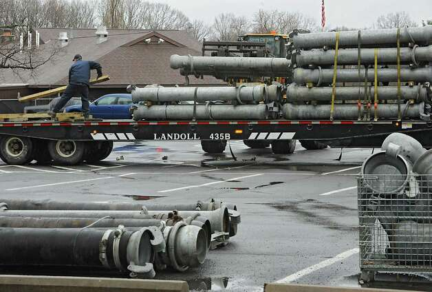 Construction crew unloads piping to pump out flood water due to a mudslide in the Norman Kill on Monday, April 20, 2015 in Albany, N.Y. (Lori Van Buren / Times Union) Photo: Lori Van Buren