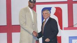 25 Jun 1997:  Center Tim Duncan of the San Antonio Spurs shakes hands with NBA Commissioner David Stern during the NBA Draft at the Charlotte Coliseum in Charlotte, North Carolina. Mandatory Credit: Craig Jones  /Allsport
