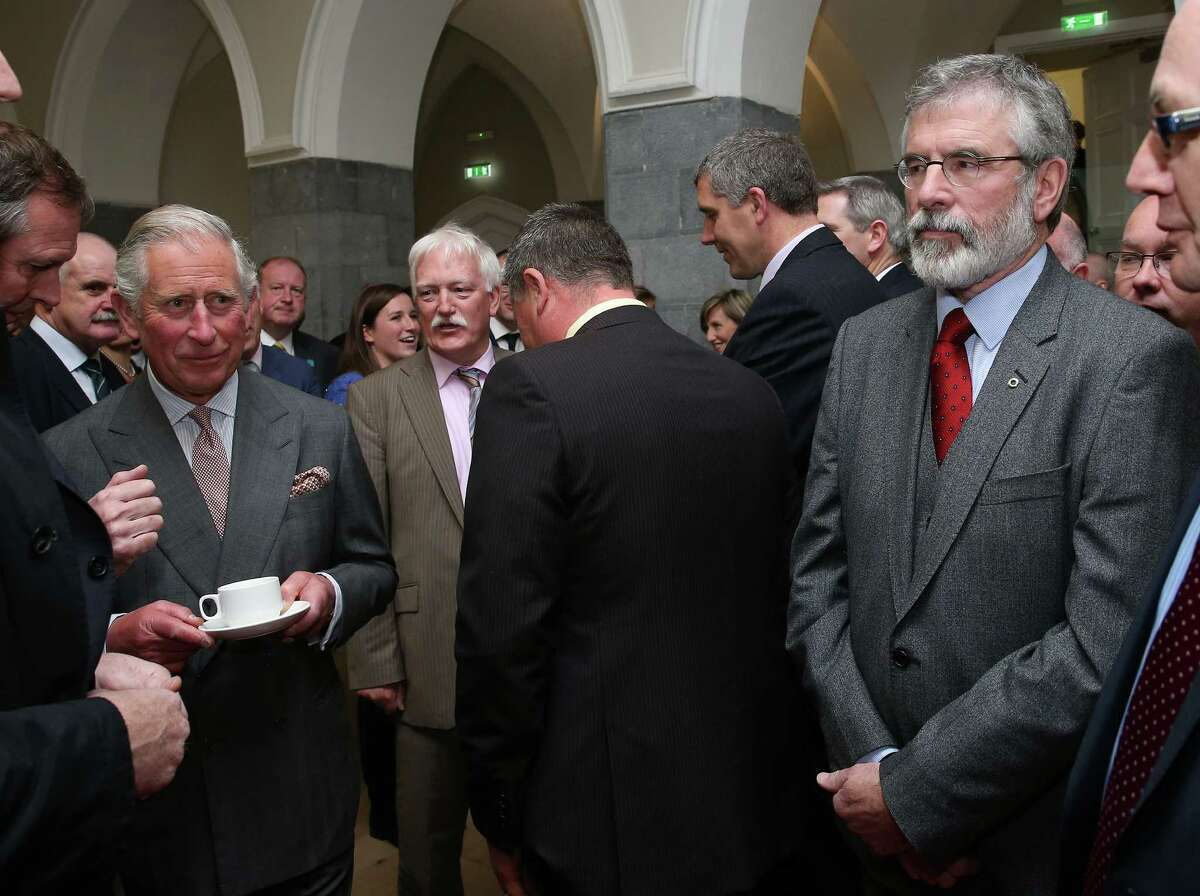 Britain's Prince Charles, left, before shaking hands with Sinn Fein president Gerry Adams at the National University of Ireland in Galway, Ireland, Tuesday May 19, 2015. Prince Charles has begun an official visit to Ireland featuring two new milestones of peacemaking: his first meeting with leaders of the Irish nationalist Sinn Fein party, and his first trip to the fishing village where the Irish Republican Army killed his great-uncle 36 years ago. It is Charles' third trip to the Irish Republic since the outlawed IRA called a 1994 cease-fire. (Brian Lawless/Pool photo via AP)