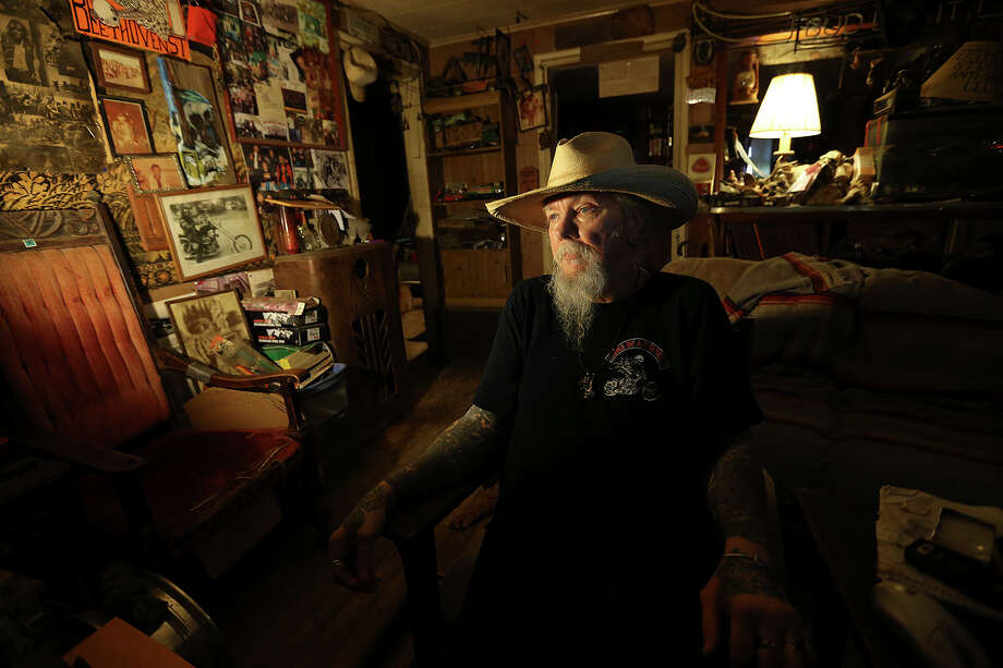Royce Showalter, 68, spends time at his Eastside house, Tuesday, May 19, 2015. Showalter is a founding member of the San Antonio chapter of the Bandidos Motorcycle Club that was started in 1967. He retired from the club in 1979. Photo: JERRY LARA, Staff / San Antonio Express-News / © 2015 San Antonio Express-News