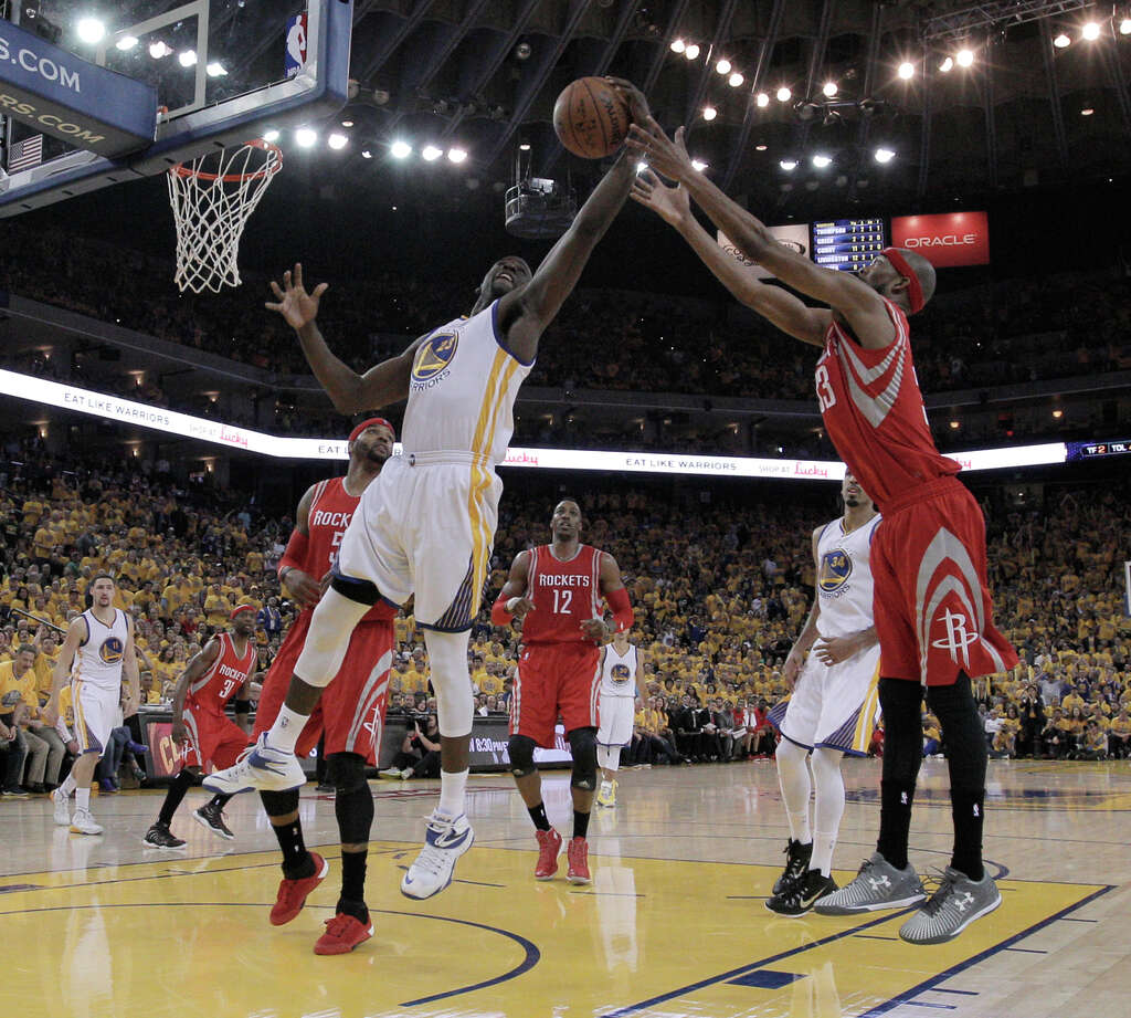 Warrior Draymond Green (23) and Rockets Corey Brewer go after a rebound during Game 1 of the Western Conference Finals on Tuesday, May 19, 2015 in Oakland, Calif. Photo: Carlos Avila Gonzalez / The Chronicle / ONLINE_YES