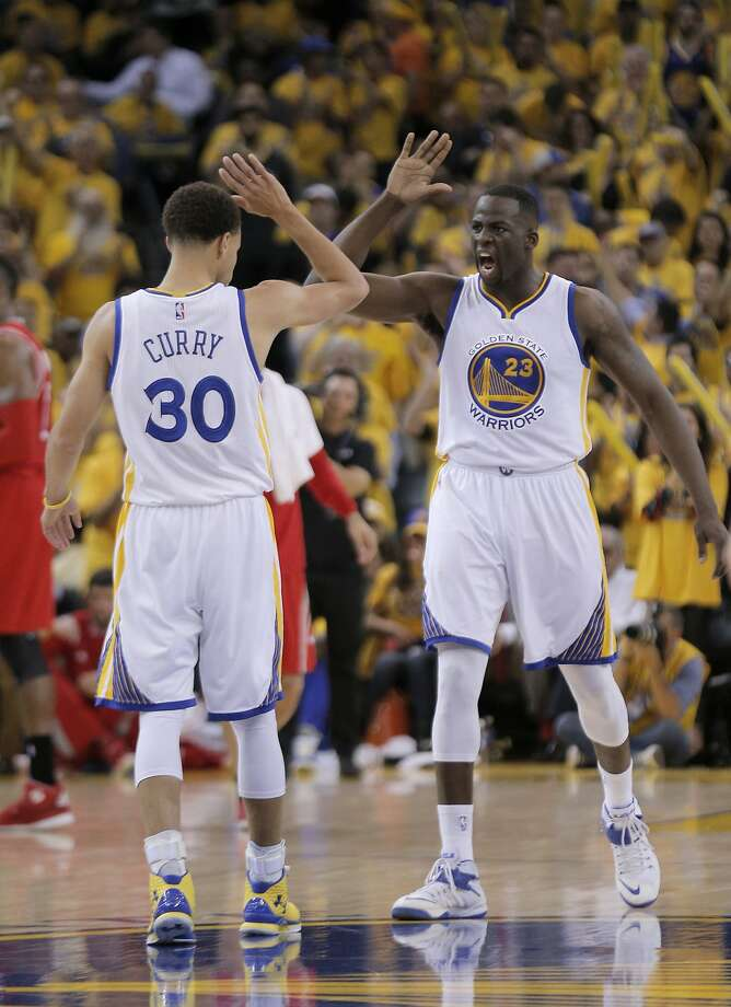 Warriors Stephen Curry (30)  and Draymond Green (23) celebrate in the first half during Game 1 of the Western Conference Finals on Tuesday, May 19, 2015 in Oakland, Calif. Photo: Carlos Avila Gonzalez, The Chronicle