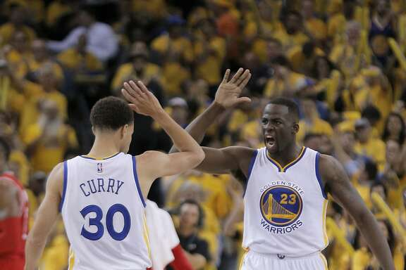 Warriors Stephen Curry (30)  and Draymond Green (23) celebrate in the first half during Game 1 of the Western Conference Finals on Tuesday, May 19, 2015 in Oakland, Calif.