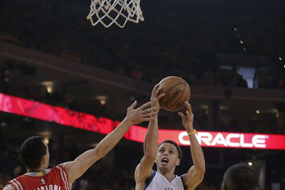 Warrior Stephen Curry (30) goes up for a first half shot against Rockets Pablo Prigioni during Game 1 of the Western Conference Finals on Tuesday, May 19, 2015 in Oakland, Calif.