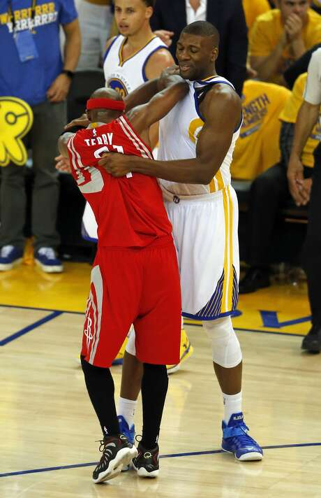 Golden State Warriors' Festus Ezeli and Houston Rockets' Jason Terry get tangled up in 3rd quarter in Game 1 of NBA Playoffs' Western Conference Finals at Oracle Arena in Oakland, Calif., , on Tuesday, May 19, 2015. Photo: Scott Strazzante, The Chronicle