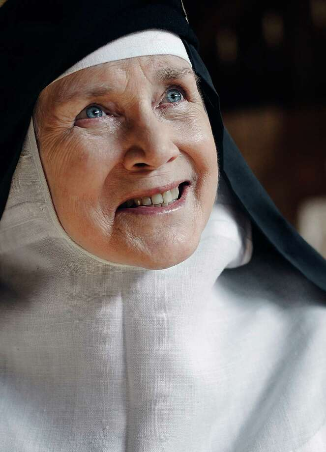 In this Friday, May 15, 2015 photo, Mother Dolores Hart poses for a photograph at the Abbey of Regina Laudis, in Bethlehem, Conn. Mother Dolores, a former actress who is best known for sharing the first on-screen kiss with Elvis Presley, has helped the Abbey which is in need of renovations gain exposure and aid from fans of Presley.  Photo: Jessica Hill, Associated Press / FR125654 AP