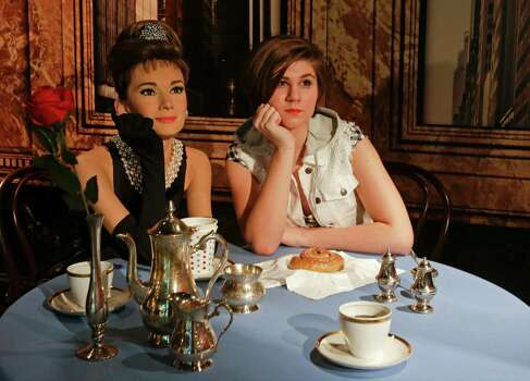 Stephanye Manley, right, poses for a photo with a wax figure of the late actress Audrey Hepburn at Madame Tussauds wax museum in Orlando. The wax museum includes a figure of Juan Ponce de Leon, who led the first European expedition to Florida. Photo: John Raoux /Associated Press / AP