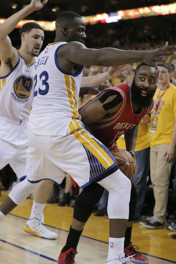 Rockets James Harden is guarded by Warriors Klay Thompson (11) and Draymond Green (23) in the fourth period during Game 1 of the Western Conference Finals on Tuesday, May 19, 2015 in Oakland, Calif. Photo: Carlos Avila Gonzalez, The Chronicle