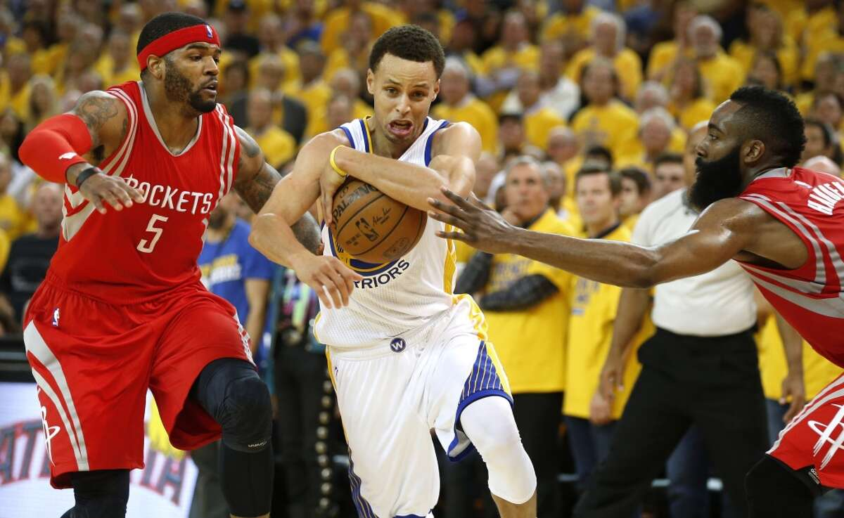 Golden State Warriors guard Stephen Curry (30) runs between Houston Rockets forward Josh Smith (5) and guard James Harden (13) during the fourth quarter of Game 1 of the NBA Western Conference Finals at Oracle Arena on Tuesday, May 19, 2015, in Oakland. ( James Nielsen / Houston Chronicle )
