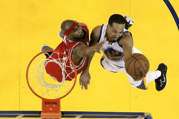 Shaun Livingston (34) shoots over Corey Brewer (33) during the first half as the Golden State Warriors played the Houston Rockets in Game 1 of the Western Conference finals at Oracle Arena in Oakland, Calif., on Tuesday, May 19, 2015. The Warriors defeated the Rockets 110-106.
