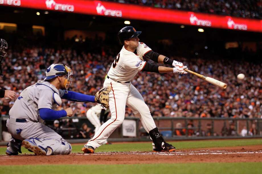 San Francisco Giants' Buster Posey hits an RBI single to score Joe Panik during the third inning of a baseball game against the Los Angeles Dodgers, Tuesday, May 19, 2015, in San Francisco. Photo: Beck Diefenbach / Associated Press / FR170639 AP
