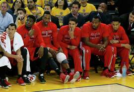Houston Rockets center Dwight Howard, third from left, sits on the bench with his knee wrapped during the second half of Game 1 of the NBA basketball Western Conference finals against the Golden State Warriors in Oakland, Calif., Tuesday, May 19, 2015. (AP Photo/Tony Avelar)