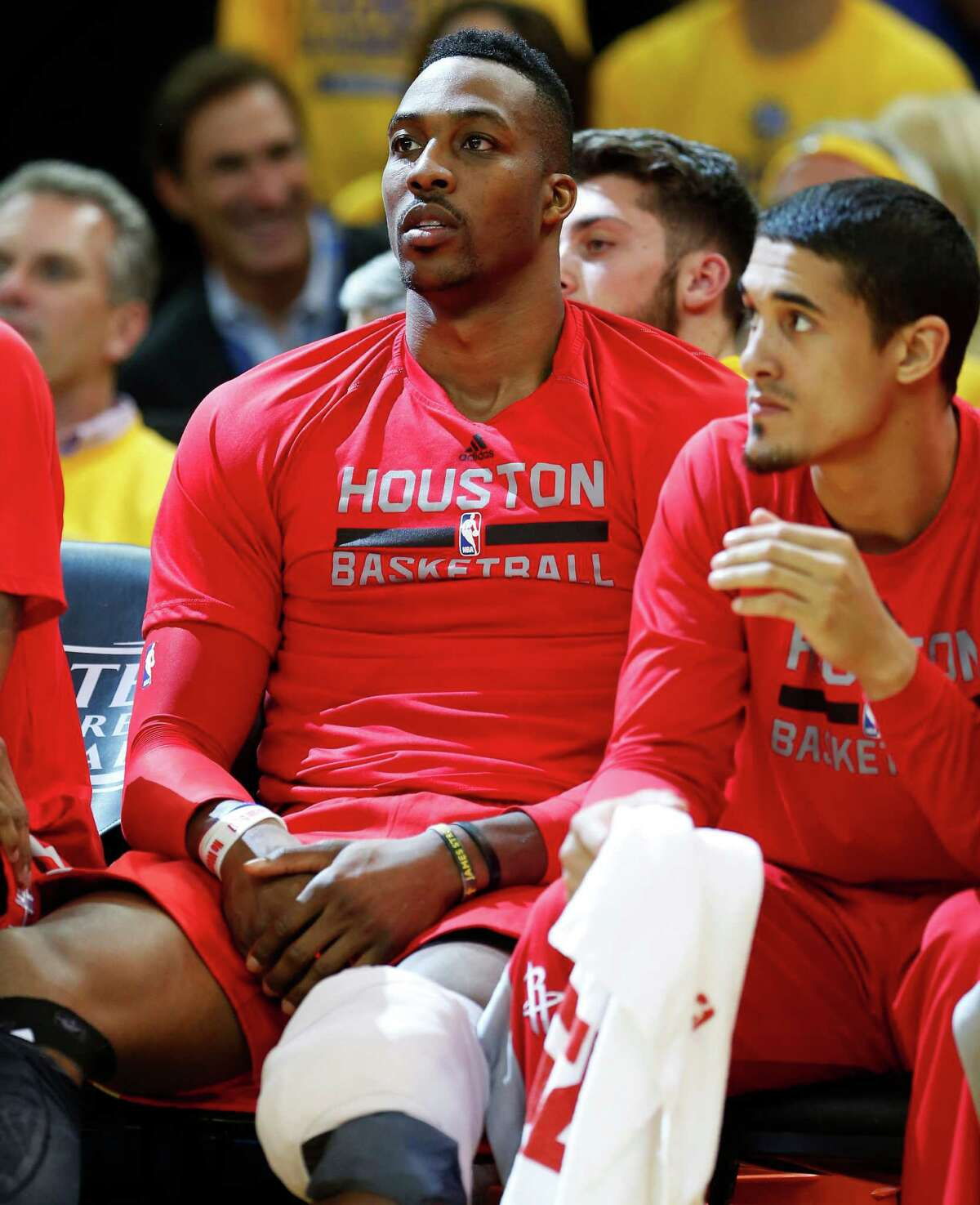 Houston Rockets center Dwight Howard (12) sits on the bench with ice on his knee during the fourth quarter of Game 1 of the NBA Western Conference Finals against the Golden State Warriors at Oracle Arena on Tuesday, May 19, 2015, in Oakland. ( James Nielsen / Houston Chronicle )