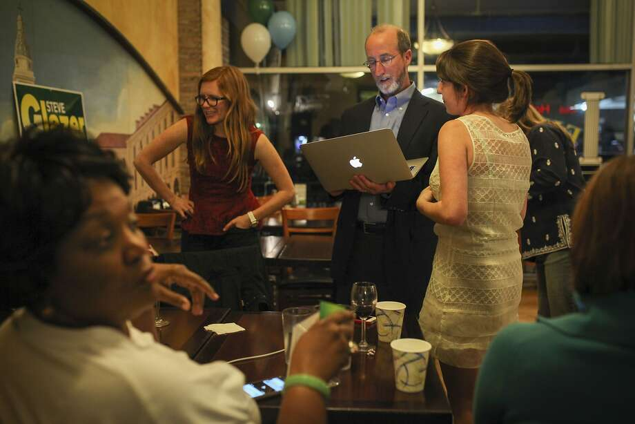 Steve Glazer who is running for East Bay State Senate seat checks election results with his supporters at Europa Hofbraus in Orinda on May 19th 2015. Photo: Sam Wolson, Special To The Chronicle