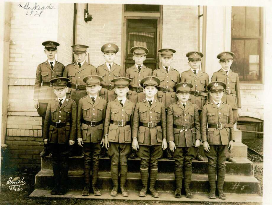 The fourth-grade class of 1924 stands at attention for a school photo at San Antonio Academy. Photo: Courtesy Photo / San Antonio Academy