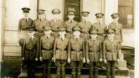 The fourth-grade class of 1924 stands at attention for a school photo at San Antonio Academy.