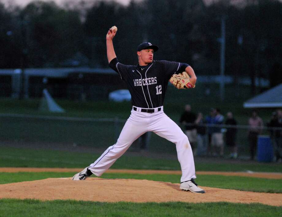 Staples pitcher Ryan Fitton throws a pitch during a game against Trumbull on Monday. Photo: Ryan Lacey/Staff Photo / Westport News Contributed