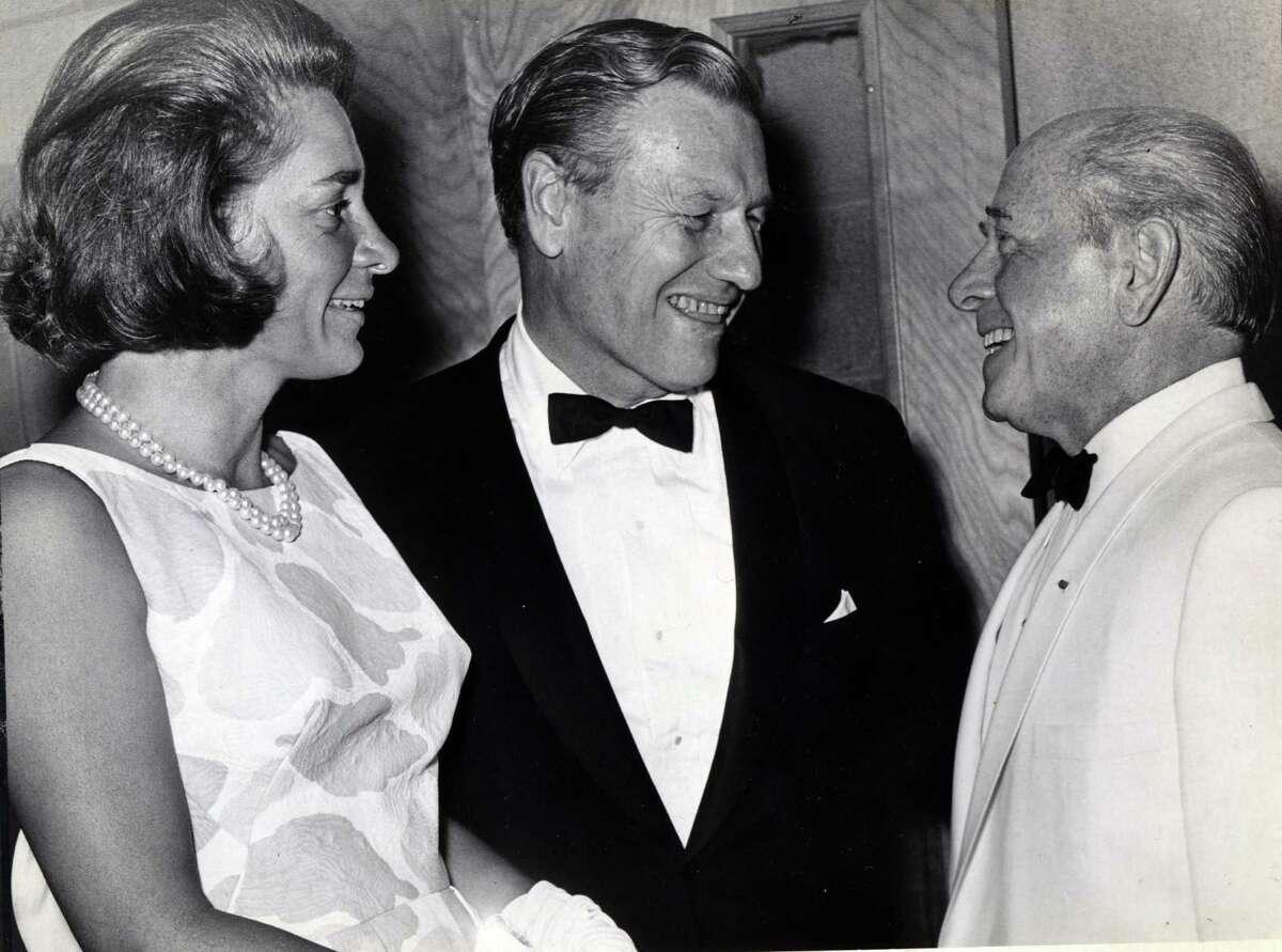 Gov. Nelson Rockefeller, center, and