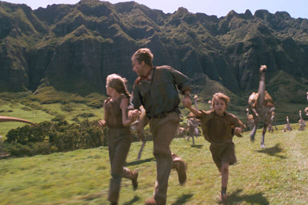 "Ariana Richards, from, left, Sam Neill and Joseph Mazzello star in ""Jurassic Park,"" which screens Friday at GreenStreet."